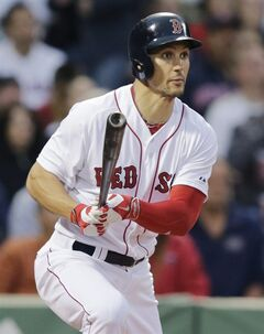 Boston Red Sox's Grady Sizemore watches his ground-rule double, which scored Mike Napoli, hit off Cleveland Indians starting pitcher Josh Tomlin during the second inning of a baseball game in Boston, Thursday, June 12, 2014. (AP Photo/Charles Krupa)