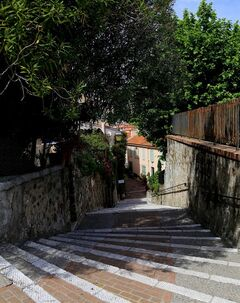 This picture, taken May 11, 2014, shows a winding stair case leading up to Le Suquet, a hillside in Cannes' Old Town where visitors can wander and enjoy sweeping views of the resort. Cannes is a favorite destination for the wealthy _ and for celebrities who walk the red carpet at the Cannes Film Festival each May _ but the Riviera resort also offers plenty of simple, inexpensive pleasures, from the beach to street strolls. (AP Photo/Michelle Locke)