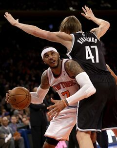 New York Knicks' Carmelo Anthony, left, looks for the basket past Brooklyn Nets' Andrei Kirilenko during the first half of the NBA basketball game at Madison Square Garden Monday, Jan. 20, 2014, in New York. (AP Photo/Seth Wenig)