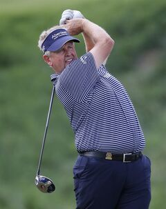 Colin Montgomerie watches his tee shot on the 14th hold in the first round of play at the 2014 U.S. Senior Open golf tournament at Oak Tree National in Edmond, Okla., Thursday, July 10, 2014. (AP Photo/Sue Ogrocki)