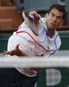 Spain's Guillermo Garcia-Lopez serves to Switzerland's Stanislas Wawrinka during the first round match of the French Open tennis tournament at the Roland Garros stadium, in Paris, France, Monday, May 26, 2014. (AP Photo/Michel Euler)