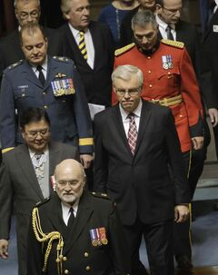 Premier Greg Selinger and Lt.-Gov. Philip Lee enter the chamber Tuesday.