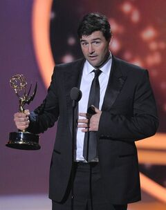 "Kyle Chandler accepts the award for outstanding lead actor in a drama series for ""Friday Night Lights"" at the 63rd Primetime Emmy Awards on Sunday, Sept. 18, 2011 in Los Angeles. (AP Photo/Mark J. Terrill)"