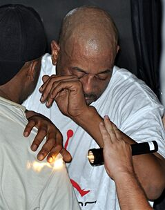 FILE - This file photo from Friday, May 29, 2009 shows rapper Tone Loc assisted during a previous collapse on stage during an outdoor performance at Capt'n Fun Beach Club on Pensacola Beach, Fla. Loc didn't want to be hospitalized after collapsing on stage during a recent weekend performance in Iowa. Loc, whose real name is Anthony T. Smith, collapsed after finishing a song during a Saturday night concert, March 16, 2013, on a downtown Des Moines bridge. (AP Photo/Pensacola News Journal, Phil Bailey, File)