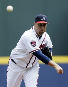 Atlanta Braves starting pitcher Aaron Harang throws in the first inning of a baseball game against the Philadelphia Phillies, Wednesday, June 18, 2014, in Atlanta. (AP Photo/David Goldman)