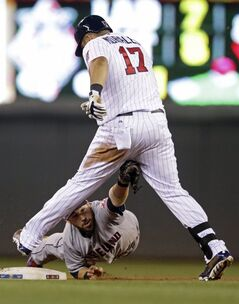 Cleveland Indians' Jason Kipnis tags out Minnesota Twins' Kendrys Morales as he tried to stretch a single into a double in the seventh inning of a baseball game, Tuesday, July 22, 2014, in Minneapolis. The Indians won 8-2. (AP Photo/Jim Mone)