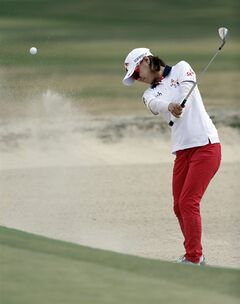Na Yeon Choi, of South Korea, hits from a bunker on the 17th hole during the third round of the U.S. Women's Open golf tournament in Pinehurst, N.C., Saturday, June 21, 2014. (AP Photo/Bob Leverone)