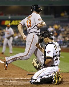 Baltimore Orioles' Chris Davis (19) scores past Pittsburgh Pirates catcher Tony Sanchez in the seventh inning of a baseball game Wednesday, May 21, 2014, in Pittsburgh. The Pirates won 9-8. (AP Photo/Keith Srakocic)