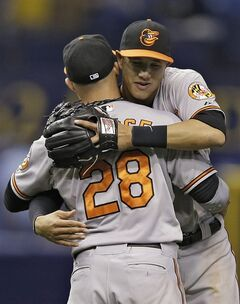 Baltimore Orioles third baseman Manny Machado, right, hugs teammate left fielder Steve Pearce after the Orioles defeated the Tampa Bay Rays 3-1 during a baseball game Thursday, May 8, 2014, in St. Petersburg, Fla. (AP Photo/Chris O'Meara)
