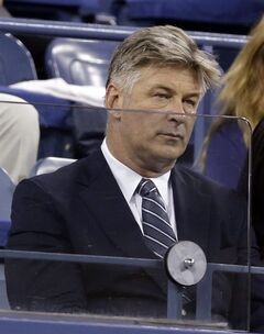 Alec Baldwin watches the match between Maria Sharapova, of Russia, and Maria Kirilenko, of Russia, during the opening round of the U.S. Open tennis tournament Monday, Aug. 25, 2014, in New York. (AP Photo/Darron Cummings)