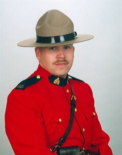 RCMP Constable James Lundblad is shown in an undated photo. An Alberta judge says RCMP should change how it trains officers to make U-turns following the death of Mountie in a traffic collision. THE CANADIAN PRESS/HO, RCMP