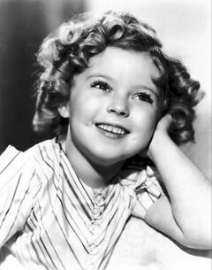 Shirley Temple Black, shown in 1935, went from being a child film star to a diplomatic career serving the United States in the United Nations and as an ambassador.