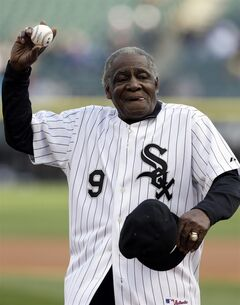 Former Chicago White Soc player Minnie Minoso throws out the ceremonial first pitch before a baseball game between the Tampa Bay Rays and the White Sox in Chicago, Saturday, April 26, 2014. (AP Photo/Nam Y. Huh)