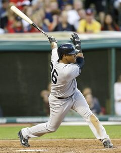 New York Yankees' Yangervis Solarte hits an RBI-single off Cleveland Indians starting pitcher T.J. House in the fifth inning of a baseball game Thursday, July 10, 2014, in Cleveland. Francisco Cervelli scored on the play. (AP Photo/Tony Dejak)