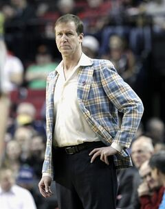 Portland Trail Blazers coach Terry Stotts watches from the bench during the first half of an NBA basketball game against the Utah Jazz in Portland, Ore., Friday, Feb. 21, 2014. (AP Photo/Don Ryan)