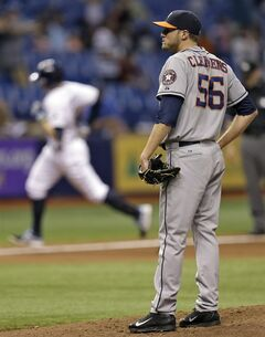 Houston Astros relief pitcher Paul Clemens (56) looks on as Tampa Bay Rays' Evan Longoria rounds the bases after hitting a home run during the seventh inning of a baseball game on Thursday, June 19, 2014, in St. Petersburg, Fla. (AP Photo/Chris O'Meara)