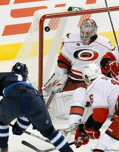 Jets centre Bryan Little snaps one past Hurricanes goaltender Cam Ward in the second period.