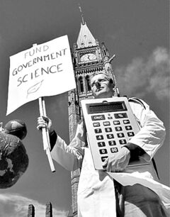 Scientists rally on Parliament Hill in Ottawa on Monday, September 16, 2013 as Canadian scientists and their supporters hold demonstrations across the country, calling on the federal government to stop cutting scientific research and muzzling its scientists.