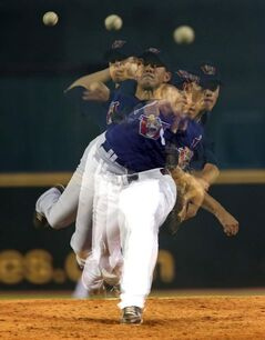 This multiple exposure image shows Winnipeg Goldeyes' pitcher Matt Rusch throwing early in the game Friday.