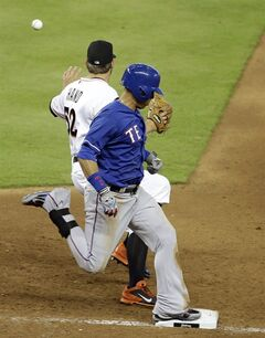 Texas Rangers' Leonys Martin, right, is safe at first with a single as he beats the throw to Miami Marlins relief pitcher Brad Hand (52) in the sixth inning during an interleague baseball game, Wednesday, Aug. 20, 2014, in Miami. (AP Photo/Lynne Sladky)