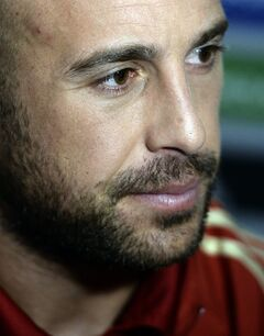 Spain's goalkeeper Pepe Reina attends to the media at the Atletico Paranaense training center in Curitiba, Brazil, Sunday, June 15, 2014. Spain will play in group B of the Brazil 2014 World Cup. (AP Photo/Manu Fernandez)