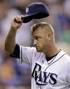 Tampa Bay Rays starting pitcher Alex Cobb tips his hat to the crowd as he is taken out of the game against the New York Yankees during the eighth inning of a baseball game Friday, Aug. 15, 2014, in St. Petersburg, Fla. (AP Photo/Chris O'Meara)
