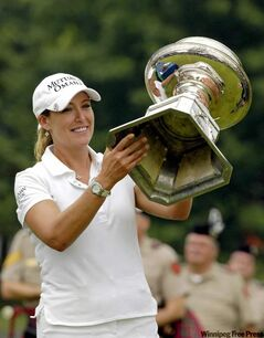 Cristie Kerr hoists the trophy after a dominating performance to win the LPGA Championship by 12 strokes.