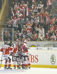 Canada's cheering section gives the players an assist celebrating the team's fifth goal Sunday.