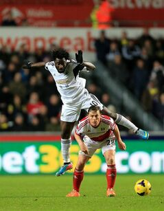 Fulham's Scott Parker, below, and Swansea City's Wilfried Bony battle for the ball during their English Premier League soccer match at the Liberty Stadium, Swansea, Wales, Tuesday, Jan. 28, 2014. (AP Photo/Nick Potts, PA Wire) UNITED KINGDOM OUT - NO SALES - NO ARCHIVES