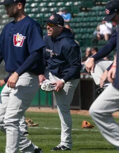 Goldeyes leftfielder Jon Weber stretches with the team on the first day of 2012 training camp at Shaw Park on Saturday.