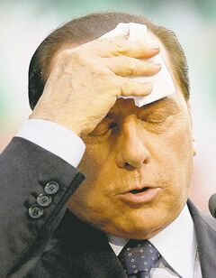 Silvio Berlusconi, seen in a 2009 file photo, was convicted of paying  for sex with an underage prostitute.