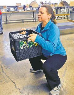 Tammy Watson, Winnipeg Harvest's volunteer services co-ordinator, does some exercises to keep fit.