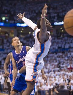 Oklahoma City Thunder's guard Reggie Jackson loses the ball late in the game and no foul was called during the second half in Game 5 of the NBA Western Conference semi-finals at the Chesapeake Arena in Oklahoma City on Tuesday, May 13, 2014. (AP Photo/The Orange County Register, Michael Goulding) ///ADDITIONAL INFO.01.clippers.0514.mg- 05/13/2014 - MICHAEL GOULDING, ORANGE COUNTY REGISTER - Clippers v Thunder Game 5 Western Conference semi-finals
