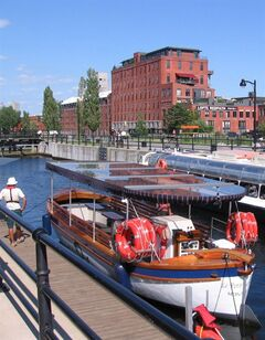 Boat tours will be offered along a five-kilometre portion of Montreal's Lachine Canal this summer, with commentary provided on the history on the waterway. THE CANADIAN PRESS/HO - Parks Canada