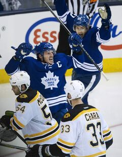 Maple Leafs captain Dion Phaneuf reacts after scoring his third-period goal against the Bruins on Sunday night in Toronto.
