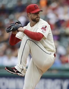 Cleveland Indians starting pitcher Corey Kluber delivers in the first inning of a baseball game against the Kansas City Royals, Sunday, July 6, 2014, in Cleveland. (AP Photo/Tony Dejak)