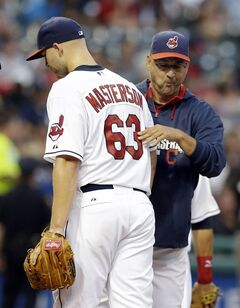 Cleveland Indians starting pitcher Justin Masterson, left, hands the ball off to manager Terry Francona in the third inning of a baseball game against the New York Yankees, Monday, July 7, 2014, in Cleveland. (AP Photo/Tony Dejak)