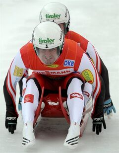 Austria's athletes Andreas Linger and his brother Wolfgang Linger at the start for the men's double competition at the Luge World Cup in St. Moritz, Switzerland, Saturday Jan. 28, 2012. (AP Photo/Keystone/Karl Mathis)