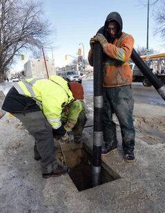 City and contract workers thaw frozen water pipes on March 10 at Mountain Avenue at Salter Street.