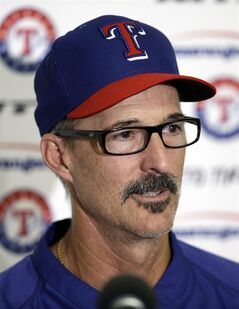 Texas Rangers pitching coach Mike Maddux responds to questions about Yu Darvish's throwing session during spring training baseball practice, Tuesday, Feb. 18, 2014, in Surprise, Ariz. (AP Photo/Tony Gutierrez)