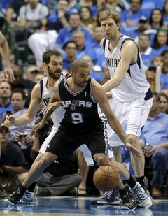 San Antonio Spurs' Tony Parker (9) attempts to get around the defense of Dallas Mavericks' Jose Calderon and Dirk Nowitzki, right, during the first half of Game 4 of an NBA basketball first-round playoff series, Monday, April 28, 2014, in Dallas. (AP Photo/Tony Gutierrez)