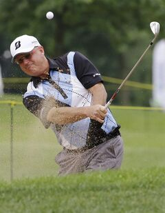 Sandy Lyle hits out of a bunker on the 17th hole during the second round of the Encompass Championship golf tournament in Glenview, Ill., Saturday, June 21, 2014. (AP Photo/Nam Y. Huh)