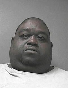 This Friday, June 13, 2014 arrest photo provided by the Volusia County Sheriff's Office, shows Christopher Mitchell, 42. Mitchell, who weighs about 450 pounds, was arrested and is facing multiple charges after sheriff's deputies say he hid cocaine and 23 grams of marijuana under his stomach fat. (AP Photo/Volusia County Sheriff's Office)