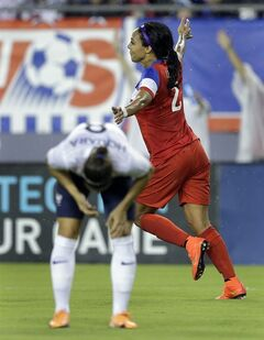 United States forward Sydney Leroux (2) celebrates in front of France defender Jessica Houara (8) after scoring during the first half of a women's friendly soccer match on Saturday, June 14, 2014, in Tampa, Fla. (AP Photo/Chris O'Meara)