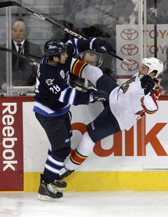 Patrice Cormier puts a hit on Florida Panthers' Kris Versteeg last season.