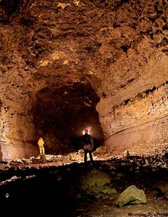Deep inside Buri Lava Tube, a kilometre of challenging subterranean hiking that ends in a 17-metre vertical chasm said to be the deepest lava pit on Earth.