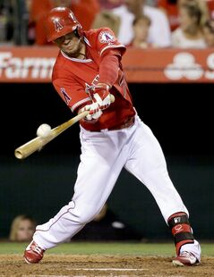 Los Angeles Angels' Collin Cowgill hits an RBI double against the Philadelphia Phillies during the sixth inning of a baseball game in Anaheim, Calif., Tuesday, Aug. 12, 2014. (AP Photo/Chris Carlson)