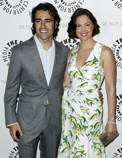 Cast member Ashley Judd, right, and Dario Franchitti arrive at a preview screening for an upcoming episode of the ABC television series