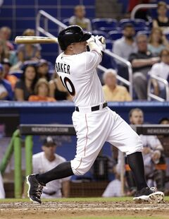 Miami Marlins' Jeff Baker (10) follows through on a two-run home run in the ninth inning during a baseball game against the St. Louis Cardinals, Wednesday, Aug.13, 2014, in Miami. The Cardinals defeated the Marlins 5-2. (AP Photo/Lynne Sladky)