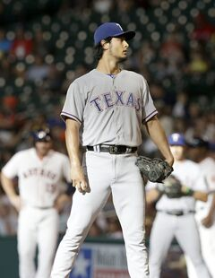 Texas Rangers starting pitcher Yu Darvish takes a moment to look to the catcher after giving up a walk to Houston Astros' Robbie Grossman (19) to start off the first inning of a baseball game Saturday, Aug. 9, 2014, in Houston. (AP Photo/Pat Sullivan)